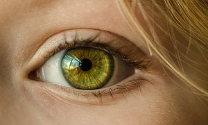 Green contact lenses, blond hair