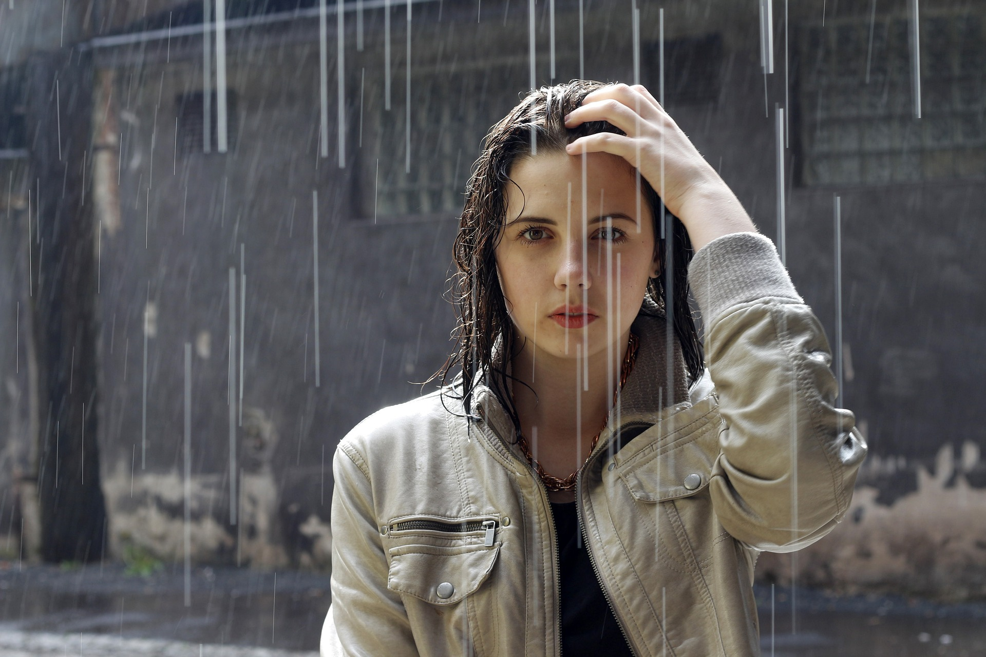 Woman embracing the rain to reduce hay fever symptoms